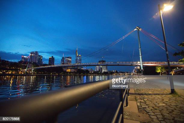 A bridge spans the River Main as skyscrapers stand beyond at dusk in Frankfurt Germany on Wednesday July 19 2017 Frankfurt has emerged as a winner of...