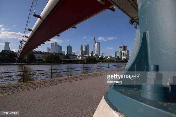 A bridge spans the River Maine as skyscrapers stand beyond in Frankfurt Germany on Thursday July 20 2017 Frankfurt has emerged as a winner of the...