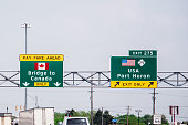 US - Canada border highway direction sign