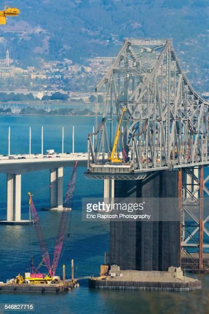Bridge under construction over bay, San Francisco, California, United States