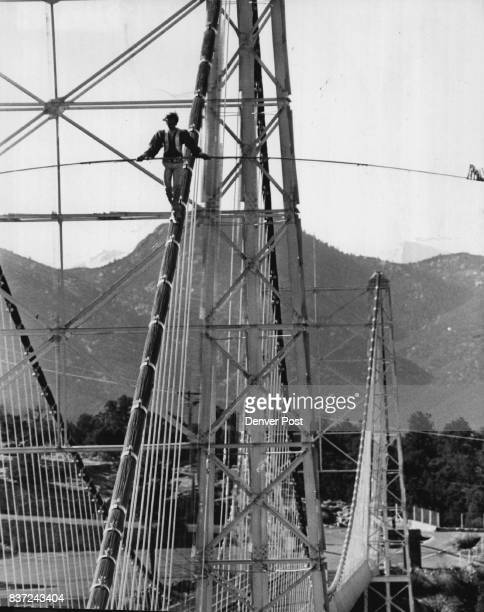 Bridge Walker Comes Down From High Places Steven Mc Peak slowly descends the support cable of Royal Gorge bridge more than 1000 feet above the...