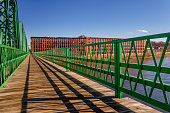 green bridge with brick textile mill buildings in Lawrence Massachusetts