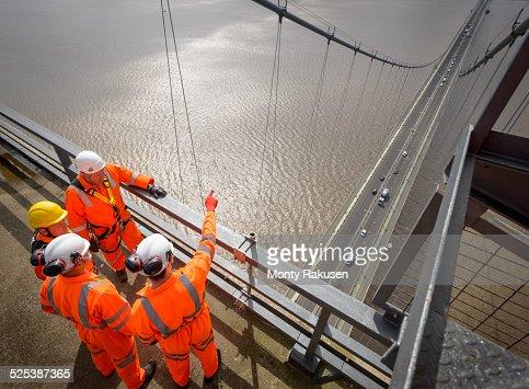 Bridge workers in meeting on top of Humber Bridge. Hessle, East Yorkshire, UK