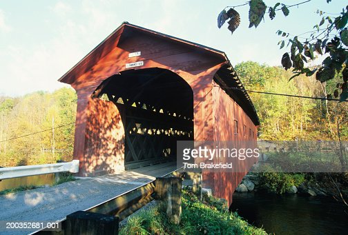 Bridge-at-the-Green dark red covered bridge in Fall built 1852, Arlington, VT, USA
