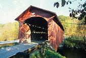 Bridge-at-the-Green dark red covered bridge in Fall built 1852, Arlington, VT, USA