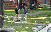 Bridgeport detectives mark shell casings after a shooting spree killed one and injured eight others at Trumbull Gardens in Bridgeport Conn on...