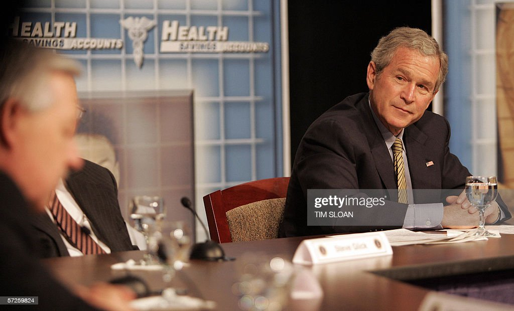 US President George W. Bush listens to a panelist during a town hall style meeting on Health Savings Accounts 04 April 2006 at the Playhouse on the Green in Bridgeport, Connecticut.