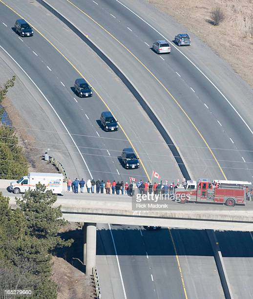 FLIGHT ONTARIO Bridges over the 401 along the portion of the roadway now called Highway of Hero's are lined with people honoring the four most...