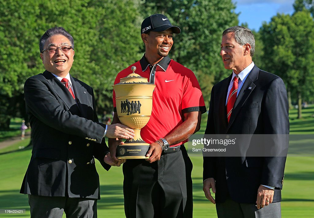 Bridgestone Global CEO and Chairman of the Board Masaaki Tsuya, Tiger Woods and CEO and President of Bridgestone Americas Gary Garfieldpose with the Gary Player Cup Trophy during the Final Round of the World Golf Championships-Bridgestone Invitational at Firestone Country Club South Course on August 4, 2013 in Akron, Ohio.