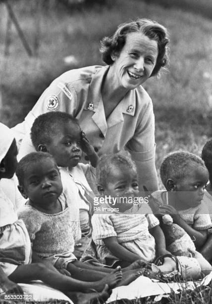 Bridget Colquhoun of Beckenham plays with youngsters from the Dagoretti Children's Center for sick and handicapped children in Nairobi Kenya where...