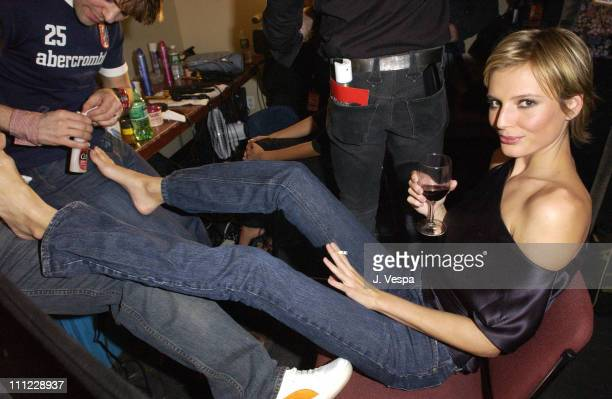 Bridget Hall gets her toenails done in the dressing room