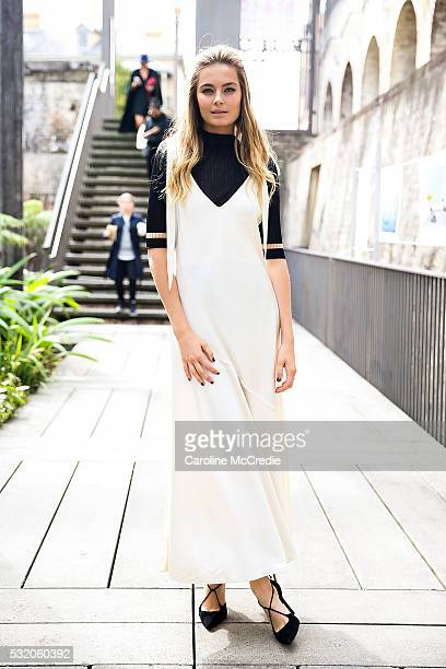 Bridget Malcolm wearing a Sportmax dress arrives ahead of the KITX show at MercedesBenz Fashion Week Resort 17 Collections at Paddington Reservoir on...