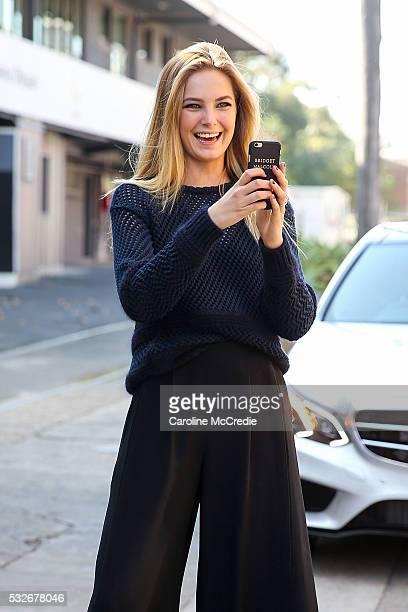 Bridget Malcolm wearing Valentino heels Proenza Schouler pants Chloe top and personalised iPhone case at MercedesBenz Fashion Week Resort 17...