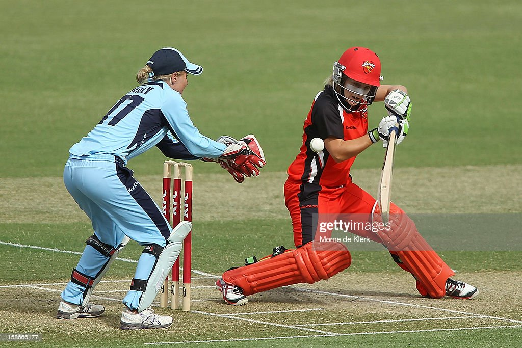 Bridget Patterson of the Scorpions bats in front of Alyssa Healy of the Breakers during the women's twenty20 match between the South Australia Scorpions and the New South Wales Breakers at Adelaide Oval on December 23, 2012 in Adelaide, Australia.