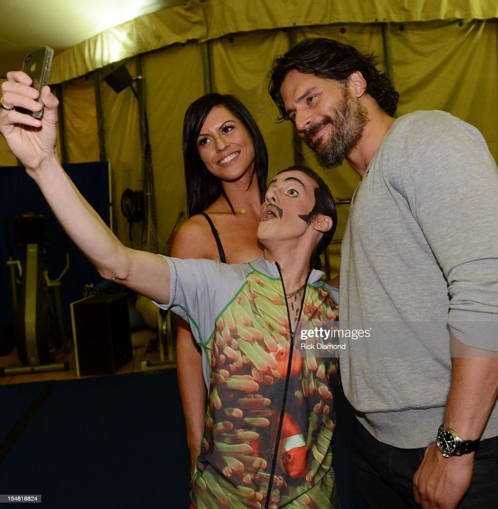 Bridget Peters, Actor Joe Manganiello and Cirque performer backstage after the Cirque du Soleil TOTEM Premiere at Atlantic Station on October 26, 2012 in Atlanta, Georgia.