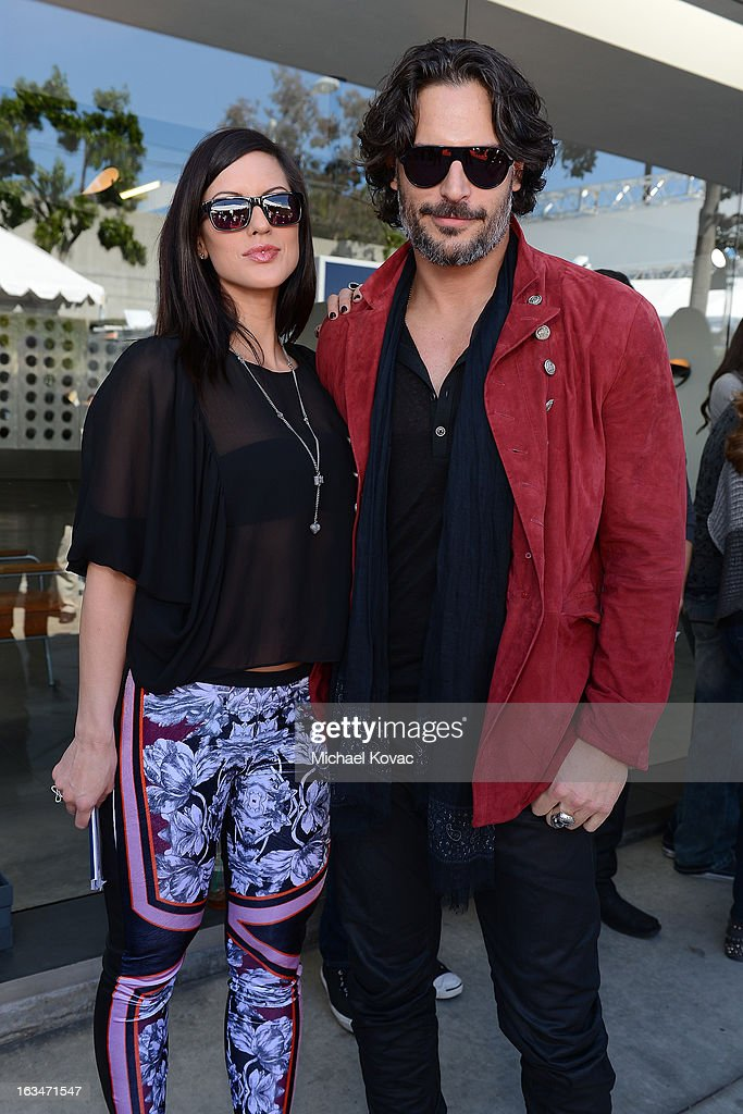 Bridget Peters (L) and <a gi-track='captionPersonalityLinkClicked' href=/galleries/search?phrase=Joe+Manganiello&family=editorial&specificpeople=2516889 ng-click='$event.stopPropagation()'>Joe Manganiello</a> wearing John Varvatos Eyewear at the 10th Annual Stuart House Benefit presented by Chrysler at John Varvatos Los Angeles on March 10, 2013 in Los Angeles, California.