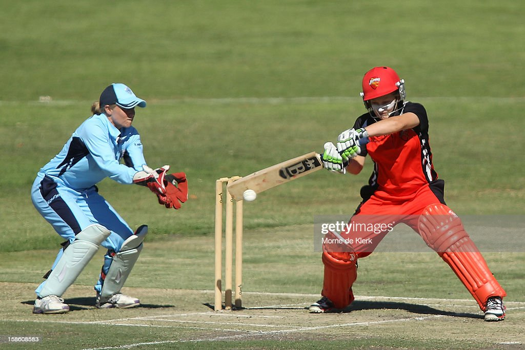 Bridget Petterson of the Scorpions bats in front of Alyssa Healy of the Breakers during the women's Twenty20 match between the South Australia Scorpions and the New South Wales Breakers at Prospect Oval on December 21, 2012 in Adelaide, Australia.