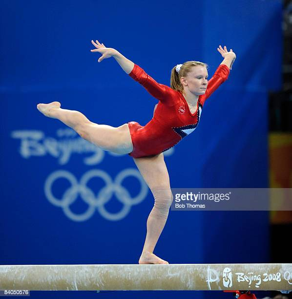 Bridget Sloan of the USA on the balance beam during qualification for the women's artistic gymnastics event held at the National Indoor Stadium...