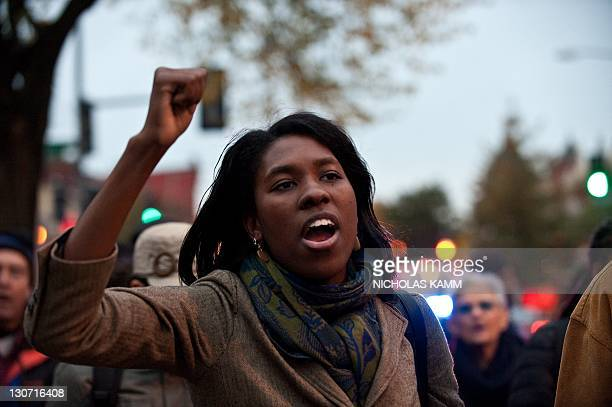 Bridget Todd a member of the English faculty at Washington's historically black Howard University leads a march of around 30 students faculty and...