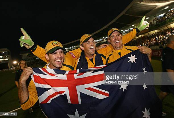 Australian cricket captain Ricky Ponting Adam Gilchrist and Matthew Hayden hold their national flag as they celebrate beating Sri Lanka in the final...