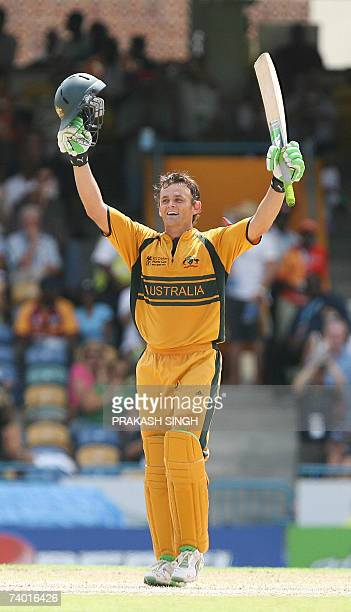 Australian cricketer Adam Gilchrist celebrates after scoring a century as he bats against Sri Lanka in the final of the ICC Cricket World Cup 2007 at...