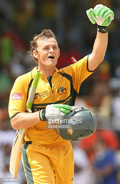Australian cricketer Adam Gilchrist celebrates his century against Sri Lanka in the final of the ICC Cricket World Cup 2007 at the Kensington Oval...