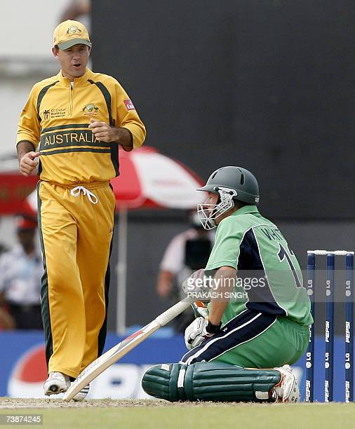 Australia's Captain Ricky Ponting runs in to check on Ireland's Andrew White after he took a ball to the head off the bowling of Glenn McGrath during...