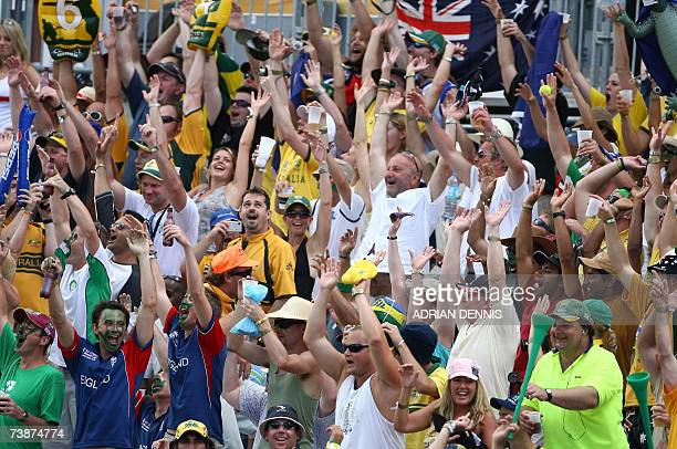 Cricket supporters in the party stand partake in the 'Mexican Wave' while watching the Ireland versus Australia game during the SuperEight ICC World...