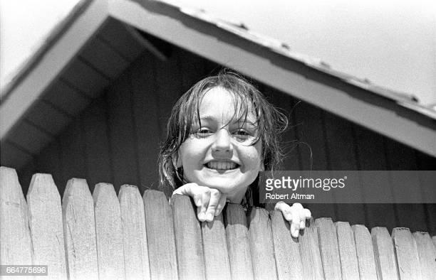 Bridgette looks over a wood fence circa March 1969 in Monterey California