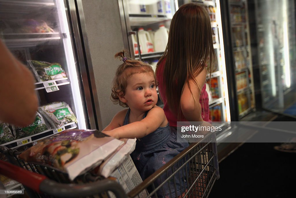 Bridgette Mooney shops for two-for-one frozen food items, as her daughter Skyler, 15 months, and cousin wait at Seal's Marketplace on August 28, 2012 in Kiln, Mississippi. Store owner Michael Seal said he put all his frozen items on sale, both for the benefit of his local clients and also to reduce his stock ahead of possible power outages due to Hurricane Isaac's arrival to the Gulf Coast area. Kiln suffered severe damage during Hurricane Katrina in 2005.