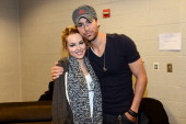 Bridgit Mendler and Enrique Iglesias pose backstage at Power 961's Jingle Ball 2012 at the Philips Arena on December 12 2012 in Atlanta
