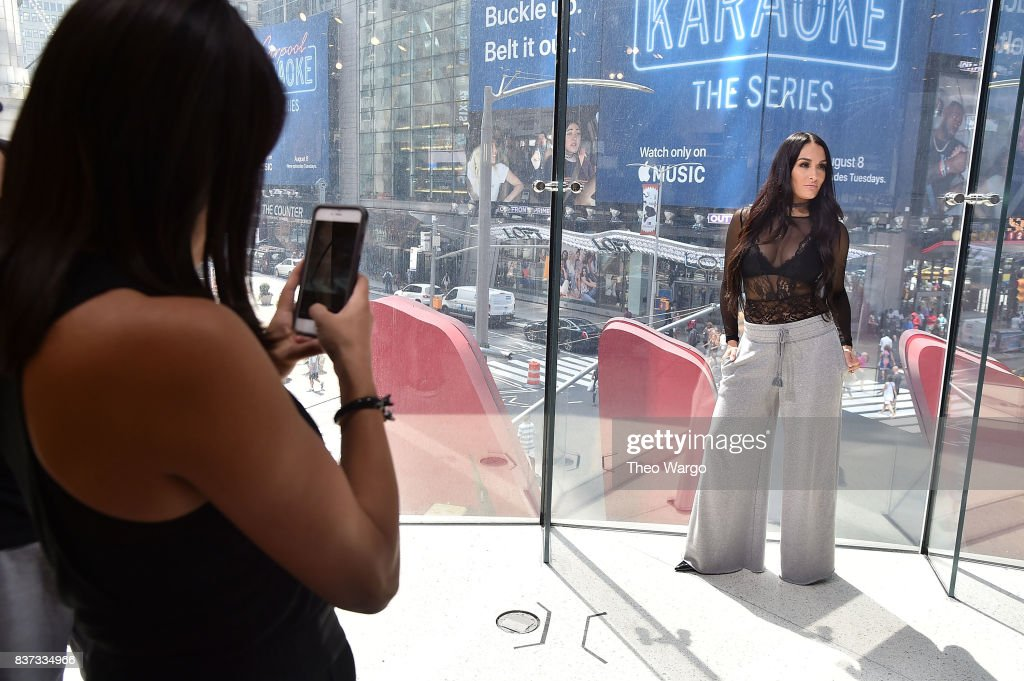Brie Bella and Nikki Bella of The Bella Twins Visit 'Extra' at H&M Times Square on August 22, 2017 in New York City.
