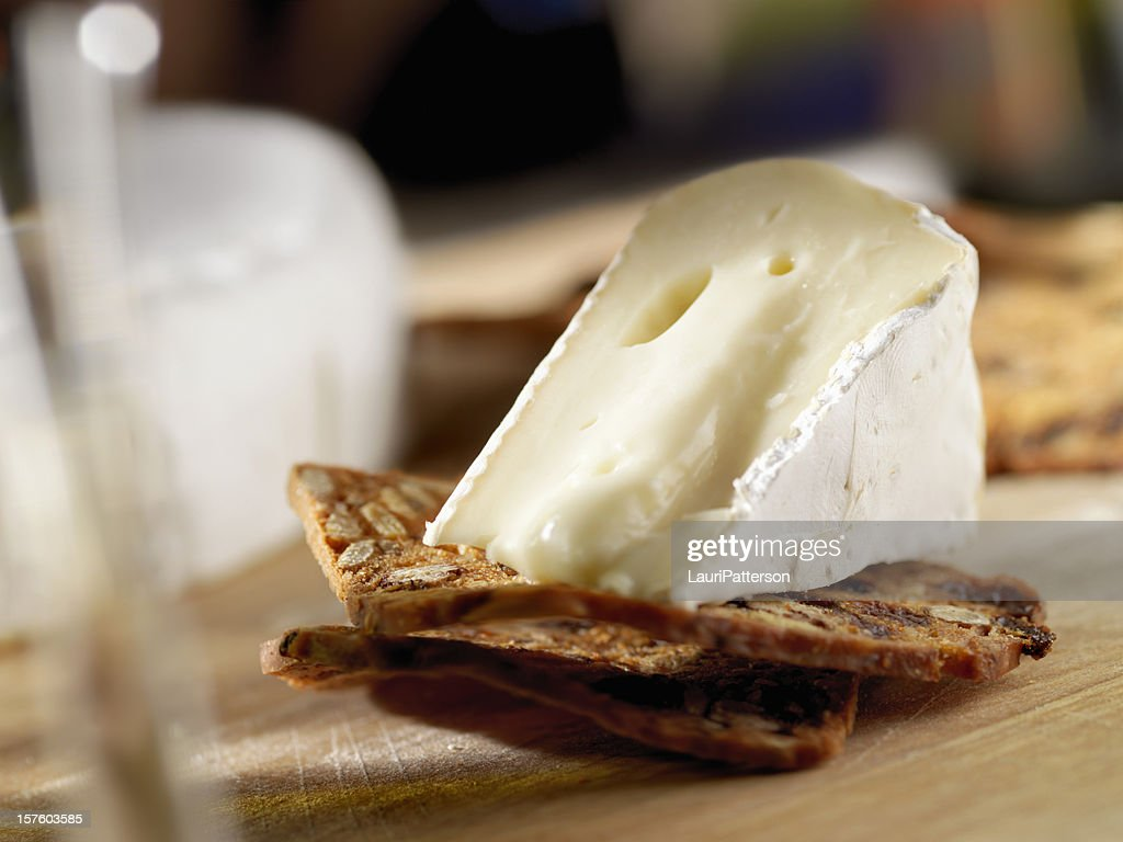 Brie Cheese on Crackers with Wine