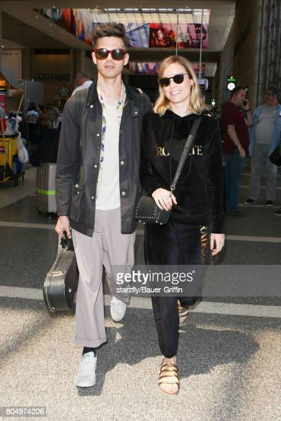 Brie Larson and Alex Greenwald are seen at LAX on June 30 2017 in Los Angeles California