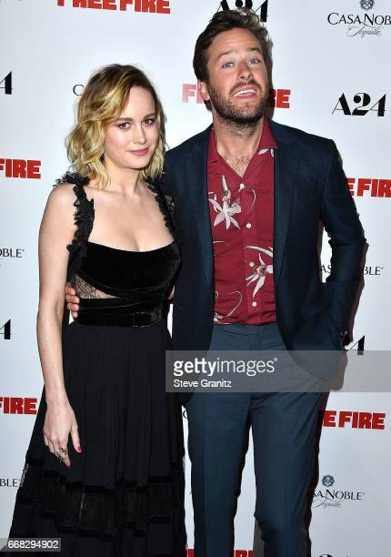 Brie Larson Armie Hammer arrive at the Premiere Of A24's 'Free Fire' at ArcLight Hollywood on April 13 2017 in Hollywood California