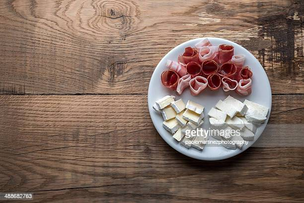 Brie, mozzarella and italian speck view from above