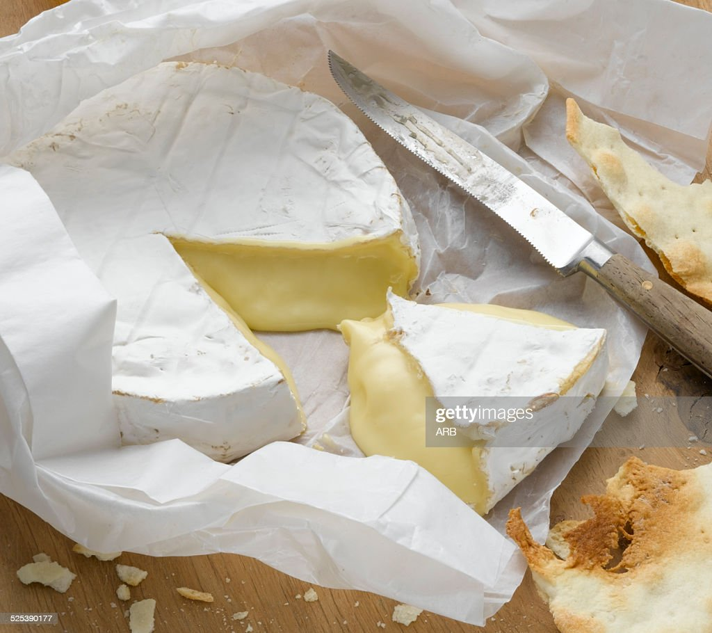 Brie wrapped in paper