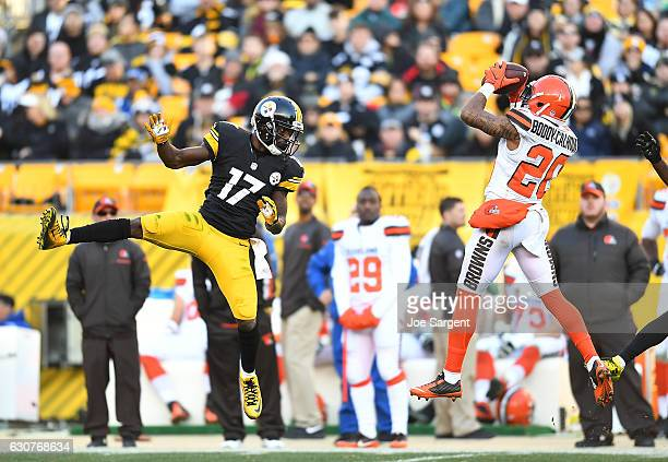 Briean BoddyCalhoun of the Cleveland Browns intercepts a pass intended for Eli Rogers of the Pittsburgh Steelers in the fourth quarter during the...