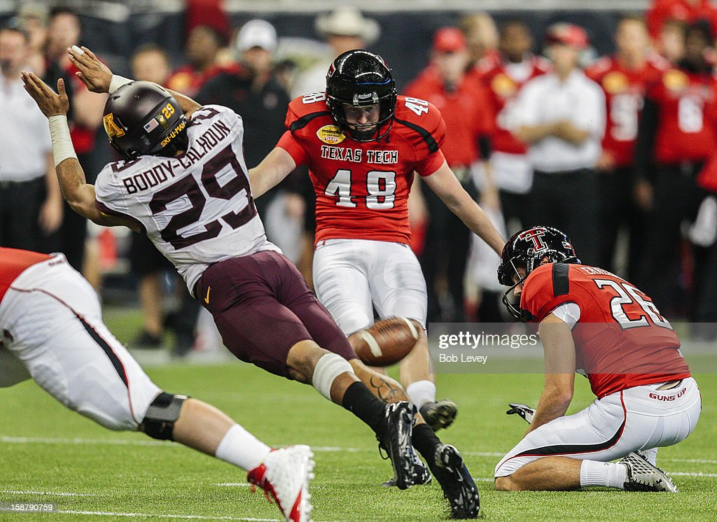Briean Boddy-Calhoun #29 of the Minnesota Golden Gophers blocks a field goal attempt by Ryan Bustin #48 of the Texas Tech Red Raiders during the Meineke Car Care of Texas Bowl at Reliant Stadium on December 28, 2012 in Houston, Texas. Texas Tech defeated Minnesota 34-31.