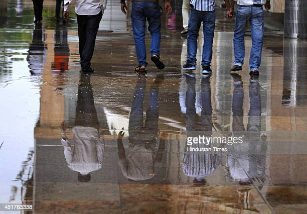 Brief spell of rain was witnessed by the people on July 6 2014 in Noida India Delhi experienced a warm day but rain in the evening brought relief...