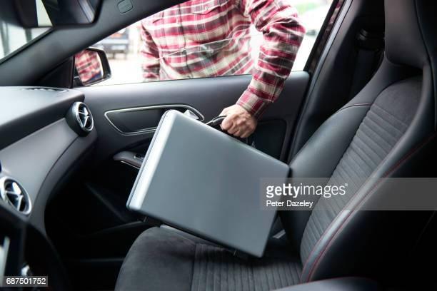 Briefcase being stolen from car