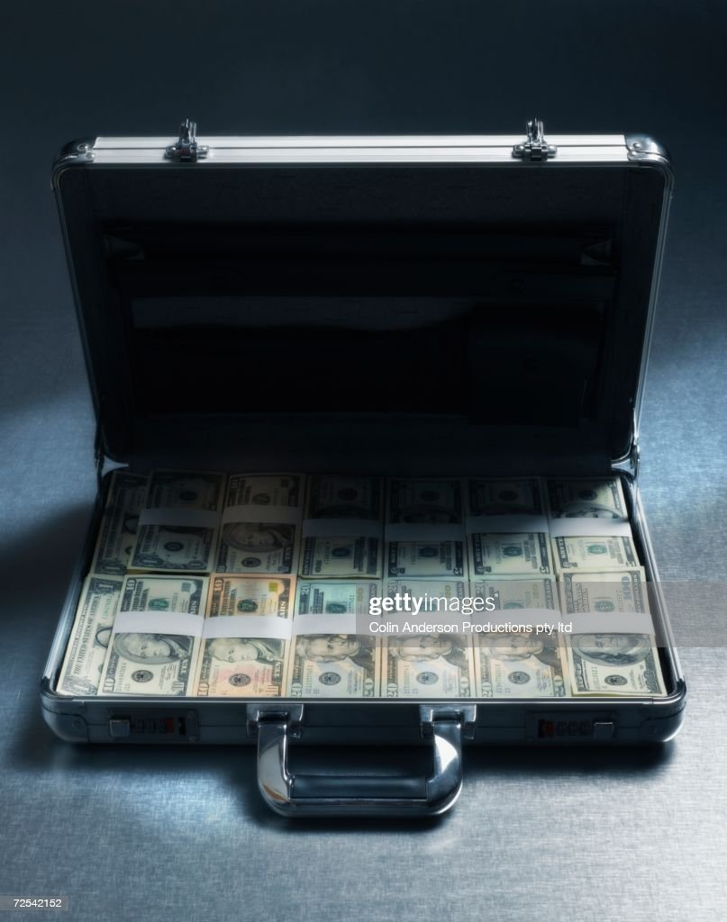 Briefcase filled with stacks of US Dollars