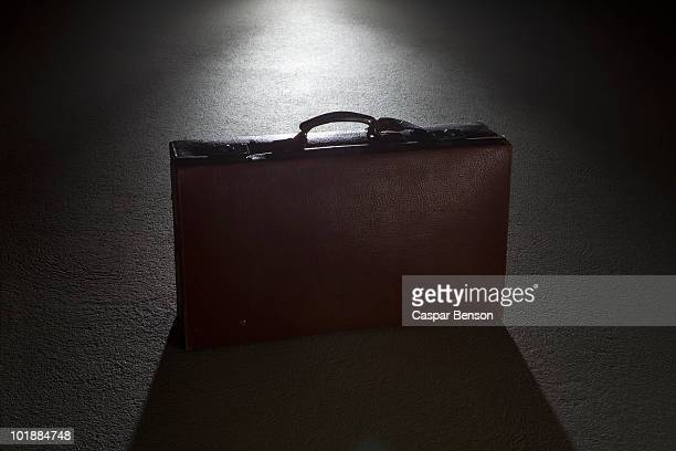 A briefcase spot lit at night