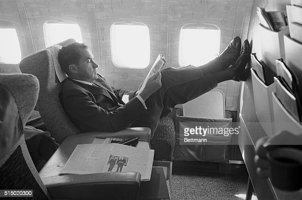 Briefs Newsmen En Route to Iceland Vice President Richard M Nixon relaxes while briefing newsmen on the flight from Poland to Iceland today after...