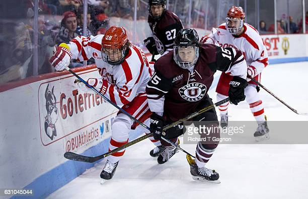 Brien Diffley of the Boston University Terriers battles against Spencer Foo of the Union College Dutchmen during NCAA hockey at Agganis Arena on...