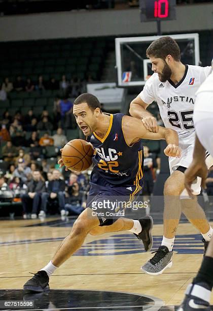 Brien of the Salt Lake City Stars drives around Patricio Garino of the Austin Spurs at the HEB Center At Cedar Park on December 3 2016 in Cedar Park...