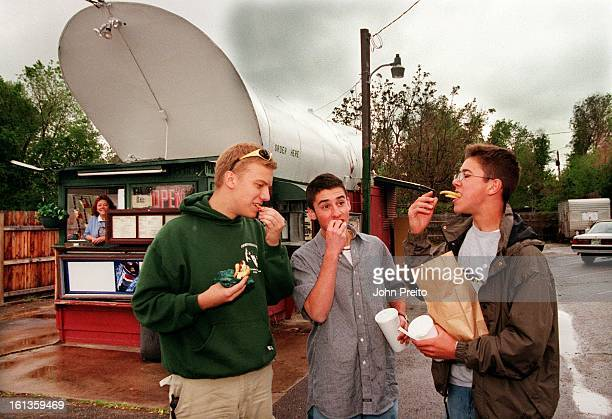 O'Brien's Wings and Things for resturant review photo of L to R Standing in front enjoying their bag of hot french fries are Nick Lumpp age 17 Colin...