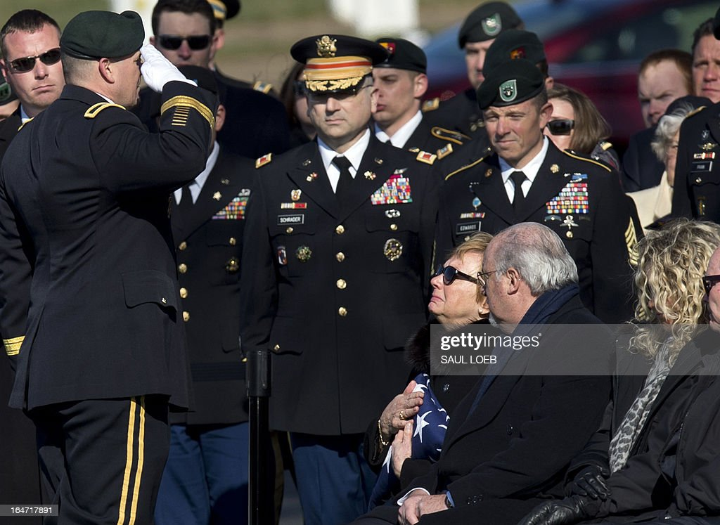 Brig. General Christopher Haas (L), commander of the US Special Forces Command in Fort Bragg, North Carolina, salutes after presenting a flag to Helen Keiser-Pedersen (C), mother of US Army Captain Andrew Pederson-Keel, during a burial service in Section 60 at Arlington National Cemetery in Arlington, Virginia, March 27, 2013. Pedersen-Keel, 28, was killed March 11 during an attack on a police station in Afghanistan. AFP PHOTO / Saul LOEB