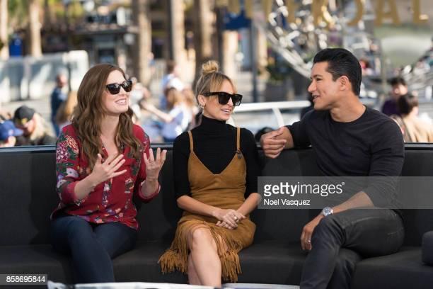Briga Heelan Nicole Richie and Mario Lopez visit 'Extra' at Universal Studios Hollywood on October 5 2017 in Universal City California