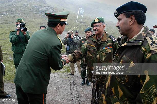 Brigade commander Brig SL Narasimhan shakes hands over the border with his Chinese counterpart at Nathu La Trade between India and China is set to...